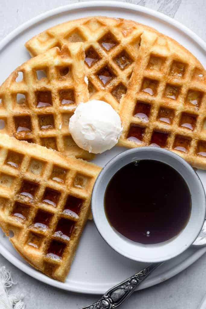 one Dairy Free Waffles with ice cream and syrup on the side