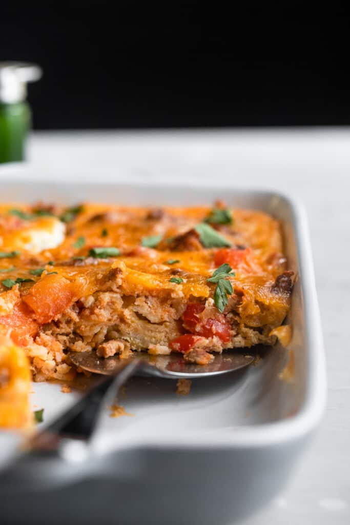 Mexican Breakfast Casserole in a baking dish with spoon