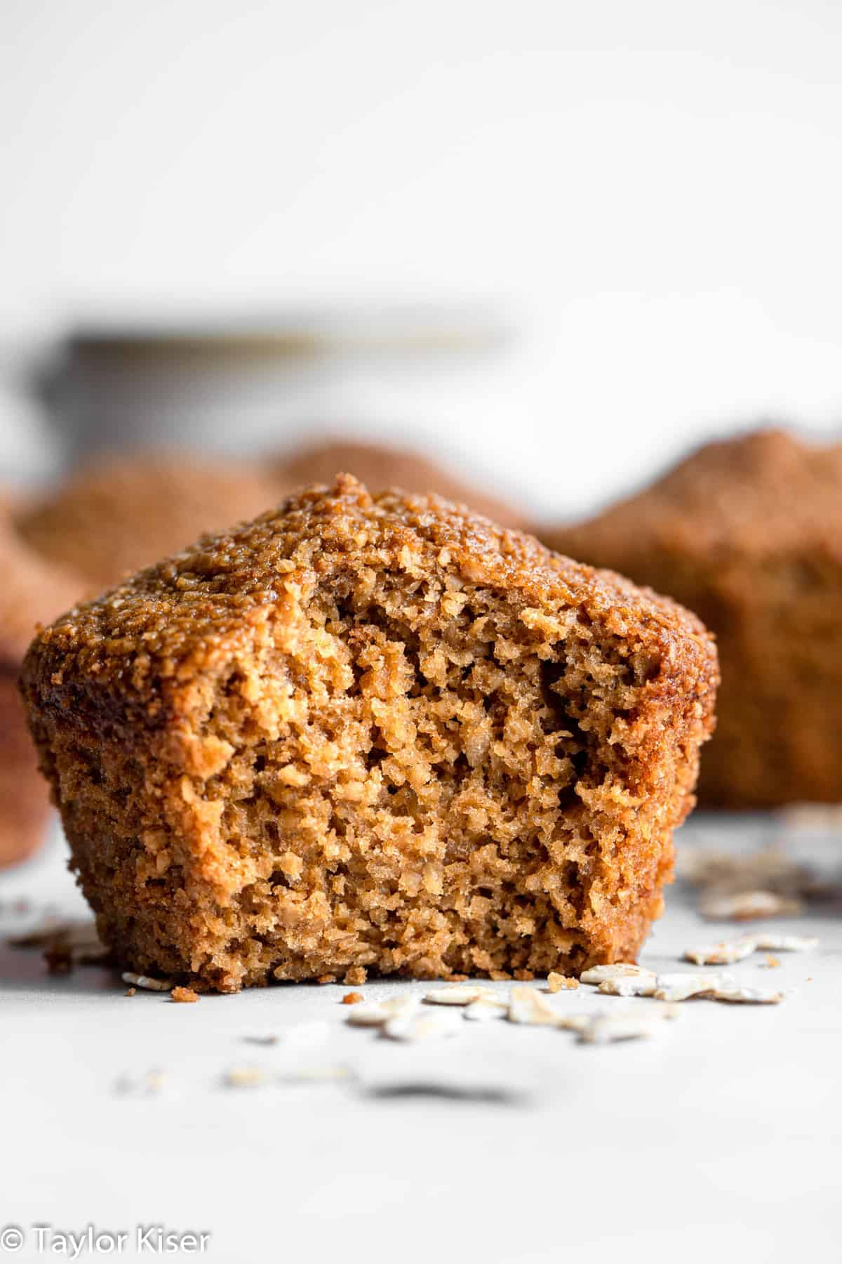 healthy oat bran muffins with a bite taken out of one