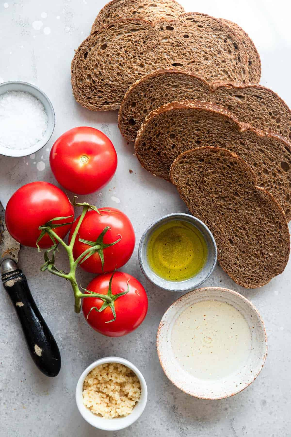 ingredients to make a pan con tomate recipe on a table